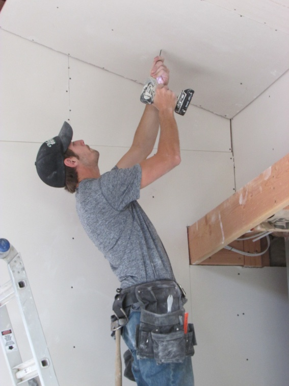 Screwing in sheetrock to the ceiling