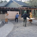 Placing plywood to protect the concrete sidewalks