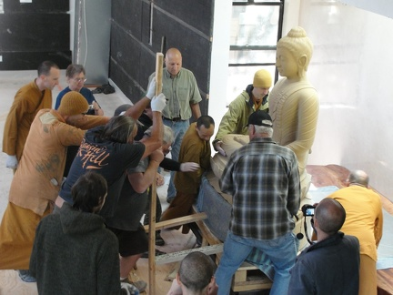 Levering the 3,000 lb Buddha into place