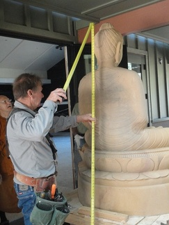 Making sure the Buddha will go through the door