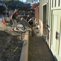 Preparing concrete pour for sidewalk outside the kitchen