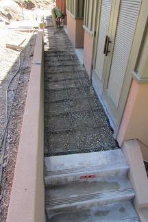 Preparing concrete pour for sidewalk outside the kitchen
