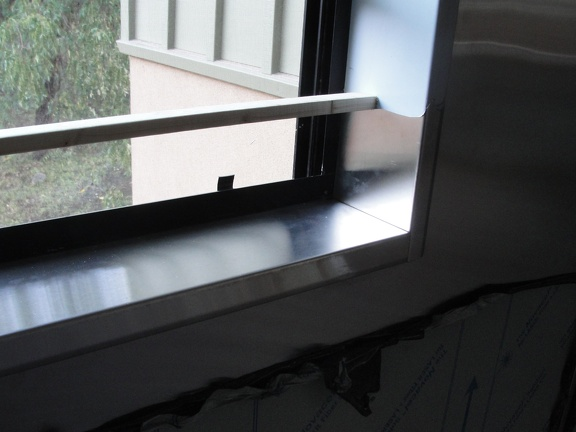 Stainless steel window sills in the kitchen