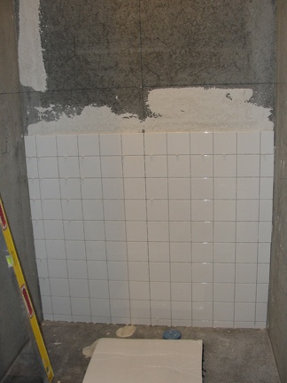 Shower tile work continues