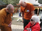 Luang Por visits with guests