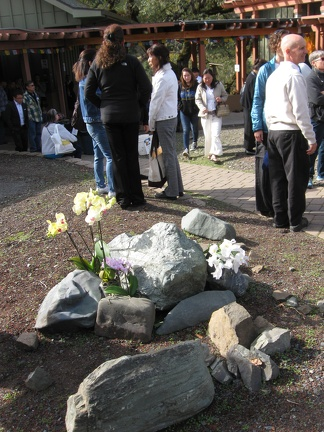 Flowers and guests dispersed throughout the monastery
