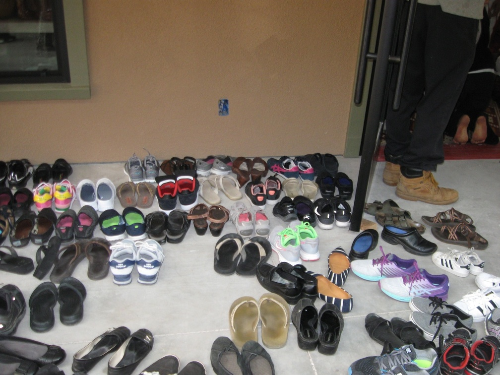 Some of the shoes of Kathina visitors outside the (new) hall