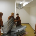Monks moving donated kitchen supplies.
