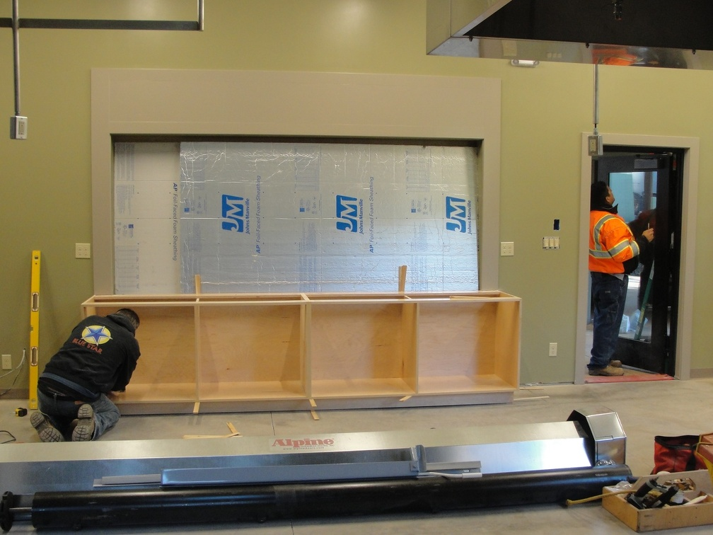Kitchen cabinets being installed