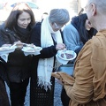Lay supporters offer rice into Luang Por's bowl