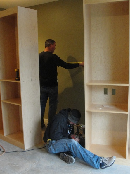 Installing cabinetry.