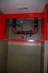 Box to hide fire suppression pipes