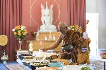 Luang Por Liem receiving food