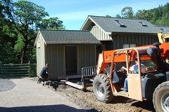 Moving the old Food Shed, it will be used as a Boot Room