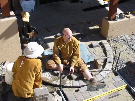Ajahn Sudanto installing the sidewalks (2006)