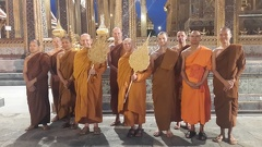 Jao Khun Phra VidesaBudhiguna (Ajahn Amaro) and Jao Khun Phra Bodhinyanavidesa (Luang Por Pasanno) stand with their ceremonial fans amidst Thai and Western Sangha