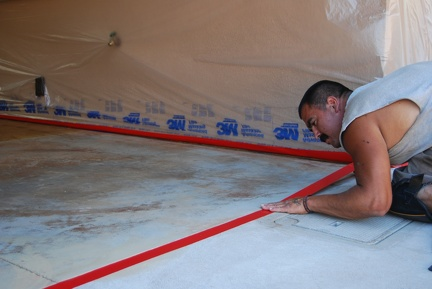 Taping off areas not to be stained