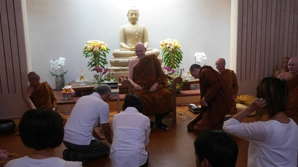 Luang Por Sumedho receiving offerings from lay visitors