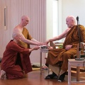 Luang Por Sumedho receives offerings from Bhikkhuni Santussika