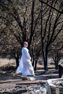 Anagarika Ryan walking through the burnt landscape