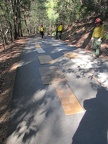 Laying out plywood to protect our road from bulldozer treads