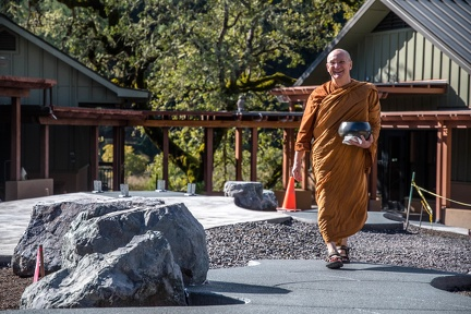 Luang Por Making his way through the new construction almost completed.