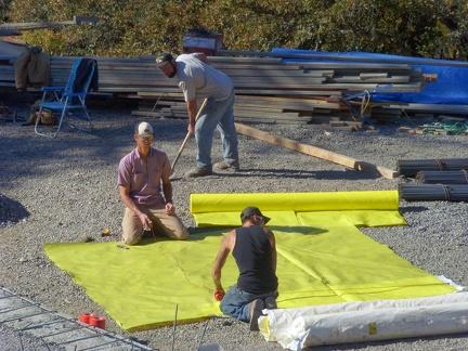 M 6 Vapor barrier being cut