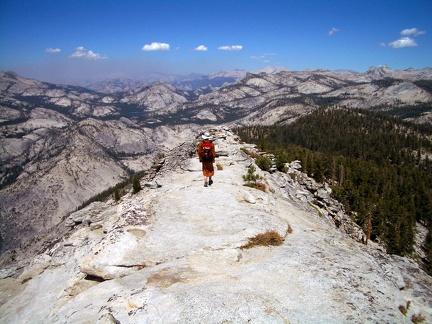 091) S. Suhajjo walking towards a cliff face