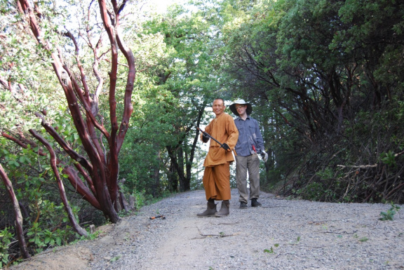 Ajahn Sek and Matt coming down the hill