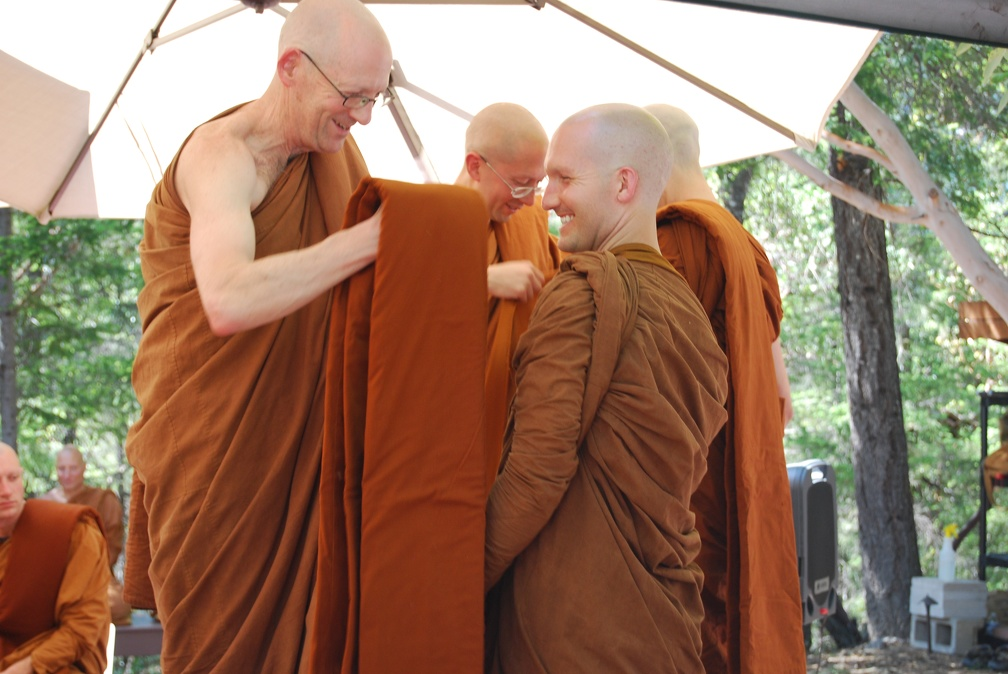 Tan Kondañño and Tan Jāgaro help the Sāmaṇeras with arranging their newly sewn robes
