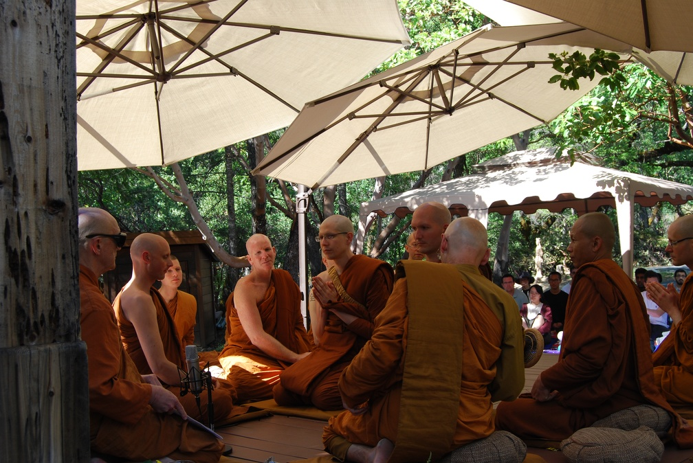 Sāmaṇeras Guṇavīro and Tissaro sit amidst the Sangha