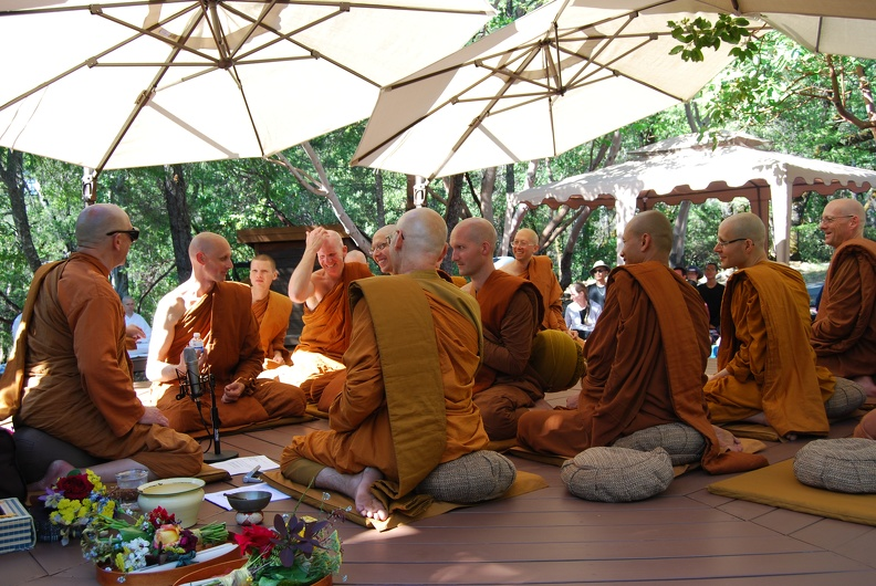A moment of levity after Ajahn Ñaniko finishes chanting