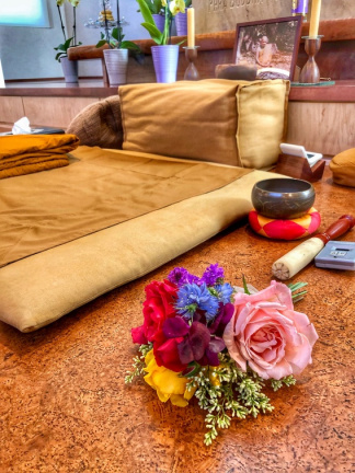 Luang Por Pasanno's seat and offering of flowers at the ceremony