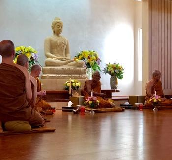 Luang Por Liem offers a teaching to the community