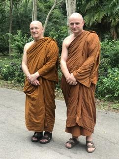 Luang Por Pasanno and Ajahn Jayasaro outside of Luang Por's cave retreat in Thailand