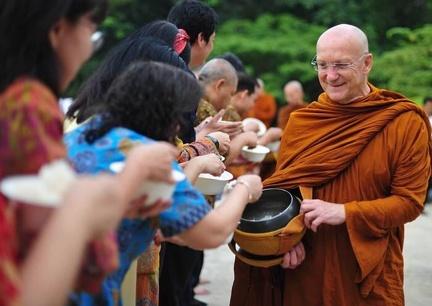 Luang Por Pasanno going for alms during Asalha Puja at Wat Ratanwan
