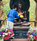 Preparing the Buddha Image for the evening's ceremony