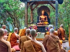 The community gathers at the outdoor meditation platform to celebrate Asalha Puja, commemorating the Buddha's first discourse with an evening of chanting, teaching, and meditation.