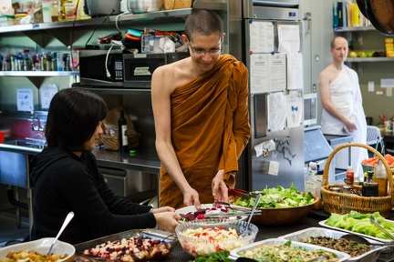 Monks receiving food for the meal