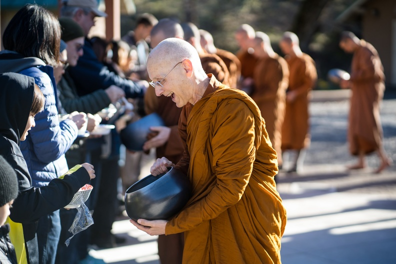 Ajahn Karuṇadhammo collecting alms