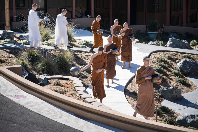 Monks walking to the meal during a rare, sunny day this winter.