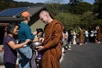A monk collects alms from the Abhayagiri lay Sangha.