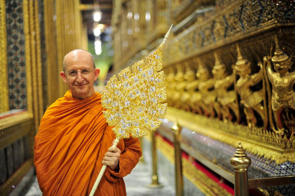 Ajahn Amaro holding his Chao Khun ceremonial fan