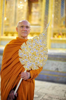 Luang Por holding his Chao Khun ceremonial fan