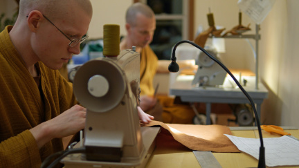 Tan Gambhīro and Tan Pesalo are up first sewing the Kathina robe