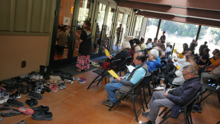 The hall was so full people gathered in the breezeway
