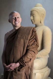 Ven. Dhammavaro poses with his triple robe set - the sabong at his waist, the jiworn across his upper body, the sanghati over his left shoulder. Multiple dyeings yielded a rich brown color distinct to madrone trees and thus unique among Buddhist monks.