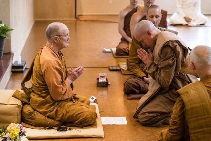 Newly-ordained monk Tan Dhammavaro bows to Luang Por Pasanno, his Preceptor.