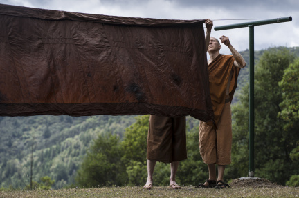 "In a process developed at the time of the Buddha, a robe will be flipped in three steps so the natural dye settles evenly on the cloth. This rotation also prevents ""racing stripes"" as dye drips down the sides."