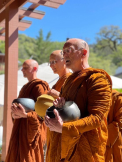 Luang Por and the monks chant a blessing